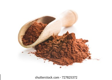 Tasty cocoa powder in wooden scoop isolated on white background.