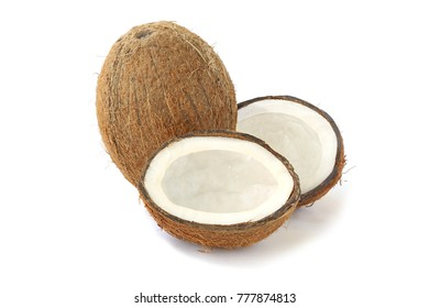 Tasty coconut and two halfs isolated on white background