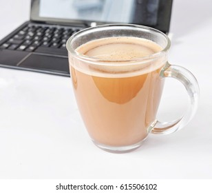 tasty coffee in glass on white background