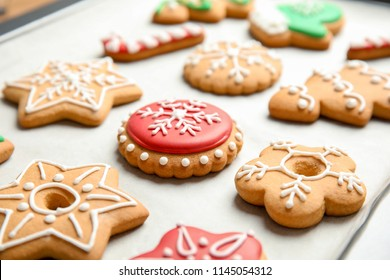 Tasty colorful Christmas cookies on baking tray
