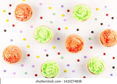 Tasty colorful cupcakes closeup on bokeh background with copy space. Birthday party sweets