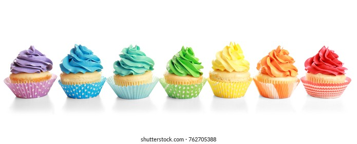 Tasty colorful cupcakes on white background