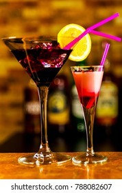 Tasty and colorful drinks based on various alcohols, syrups and liqueurs, unique effect of the bartender's work, party night