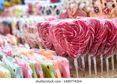 Tasty colorful lollipops different shapes on the counter fair, beautiful background