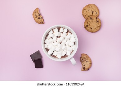 Tasty Cookies Chocolate Bars Cup of Hot Chocolate with Marshmallow Top View Flat Lay Christmas Holiday Background Christmas Beverage Pink Pastel Background