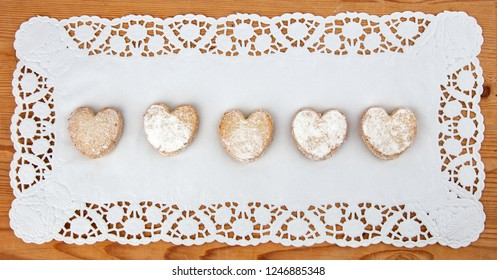 Tasty Cookies with heart shape on wooden background