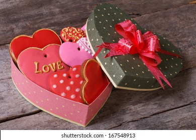Tasty cookies in valentines heart shaped box on a wooden table. Valentine's day holiday