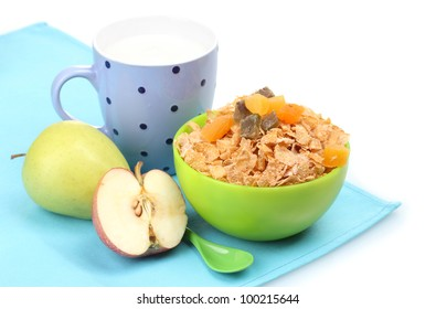 tasty cornflakes in green bowl, apples and glass of milk isolated on white