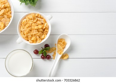 Tasty cornflakes with milk on white table.view from above, space for text.