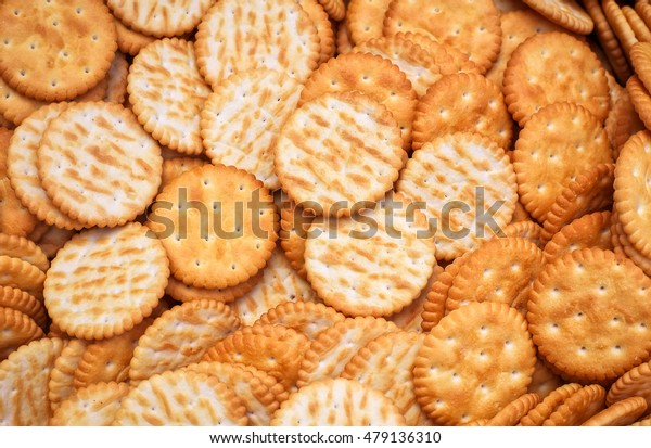Tasty crackers close up in the box. Cookies background