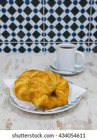 Tasty croissants with cup of tea. Spanish breakfast.