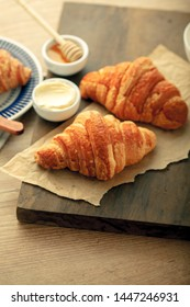 Tasty croissants French on a wooden background