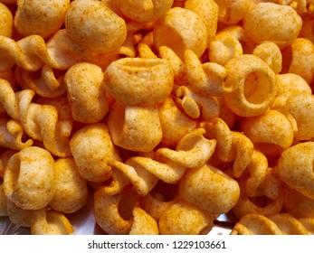 Tasty crunchy party potato crisps chips arranged in a bowl