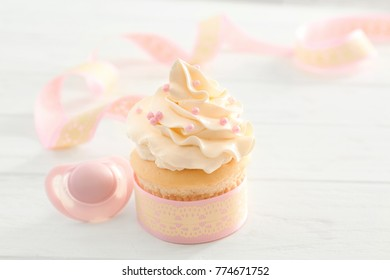 Tasty cupcake for baby shower party on table