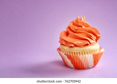 Tasty cupcake on color background