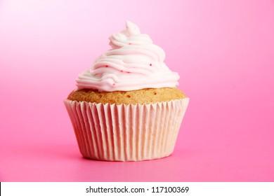 tasty cupcake, on pink background
