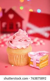 Tasty cupcake for Valentine's Day on pink table