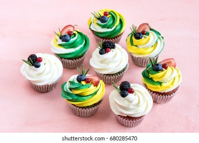 Tasty cupcakes Beautiful and colorful cupcakes decorated with fresh berries Above