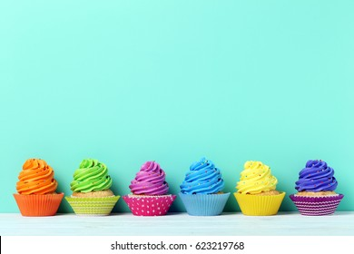 Tasty cupcakes on a green background