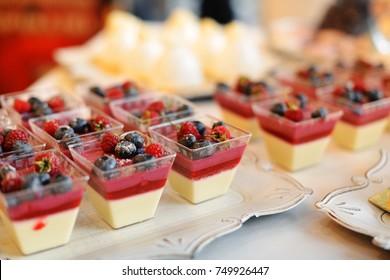 Tasty cupcakes  on white cloth. Wedding reception table