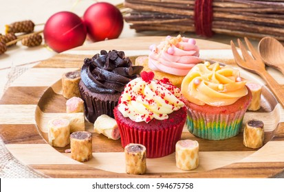 Tasty cupcakes on a wooden table