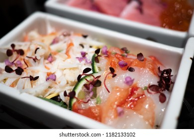 Tasty and delicious Donburi or Japanese rice bowl topped with shredded boiled Taraba Kani or King crab and fresh sashimi Taraba Kani. Garnish with micro herb. Healthy Eating and Eat Well Concept.