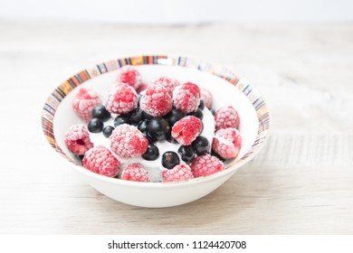 Tasty and delicious ice cream with berries on table currant and rasberry