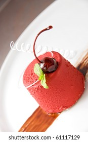 Tasty dessert of cheese, chocolate cherry, caramel and mint