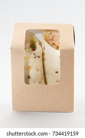 tasty doner kebabs filled with mixed vegetables and shaved spit roasted meat in tortilla wraps