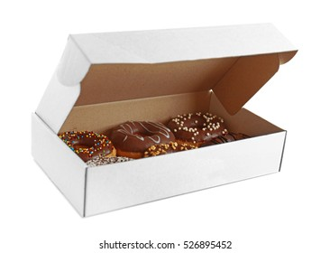 Tasty donuts in paper box on white background
