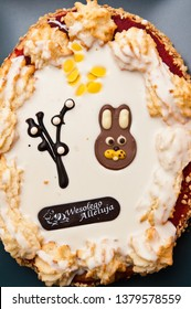 A tasty Easter cake with Polish text Happy Hallelujah. Seasonal baking concept.