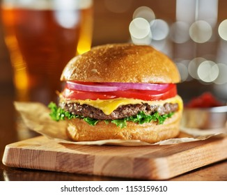 tasty fast food style cheese burger with beer