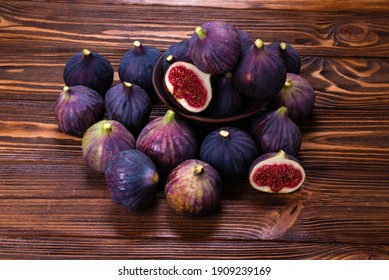 Tasty figs in a bowl on wooden background. Top view. Slices.