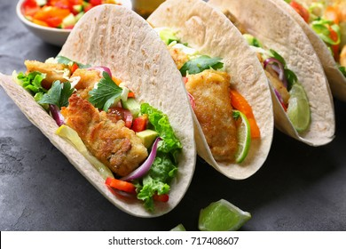 Tasty fish tacos on table