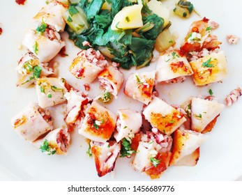 Tasty food.  Squids on a white plate.  Sea ​​food