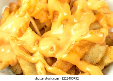 Tasty french fries with cheese sauce. Deep fry potato or appetizer.