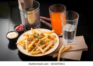 tasty french fries with drink