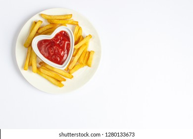 Tasty french fries on white plate with heart pattern of ketchup,white background, Valentines day