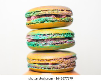 Tasty french homemade macaroons in rainbow colors, close-up on white background