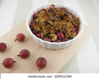 Tasty and fresh baked red gooseberry crumble