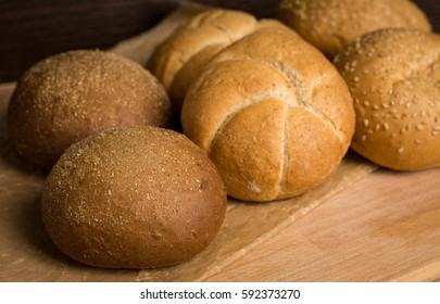 Tasty fresh buns on the wooden background