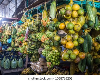 Tasty, fresh, colorful fruit and vegetable hanging on a market stall in a small town