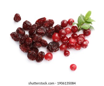 Tasty fresh and dried cranberries with leaves on white background, top view