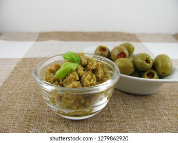 Tasty fresh homemade olive paste with basil