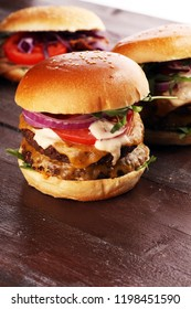Tasty fresh meat burgers with salad and cheese. Homemade angus burger