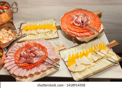 Tasty fresh meat and cheese buffet  on a wood table - Cold Buffet Spread - Serbian cheese and meat appetizer includes homemade white cheese, prosciutto (prsut) ham - finger food -Mezze Spread