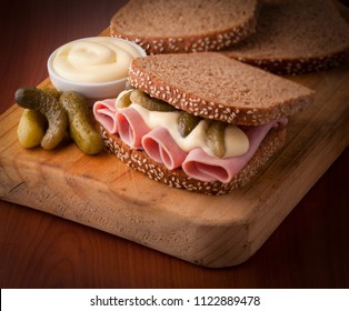 tasty and fresh mortadella sandwich with pickles