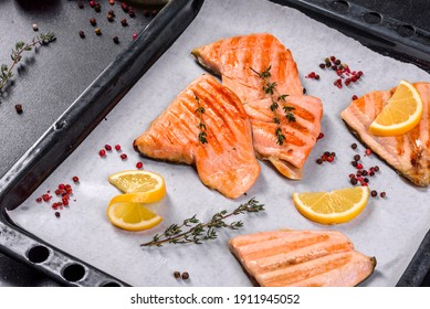 Tasty fresh red fish arctic char baked on a grill. Source of omega, healthy food