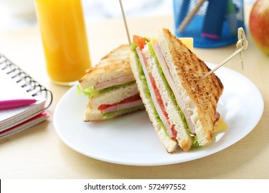 Tasty and fresh sandwiches on a brown table