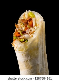 Tasty fresh shawarma on a black background